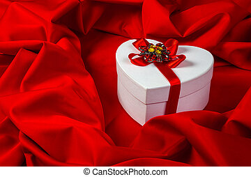 love card with heart on a red fabric - love card. white...