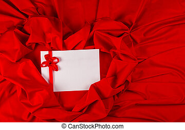 love card with ribbon on a red fabric - love card. white...