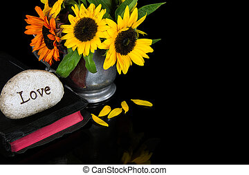 love carved in stone on Bible