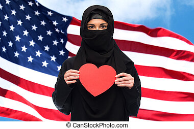 muslim woman in hijab holding red heart - love, charity,...