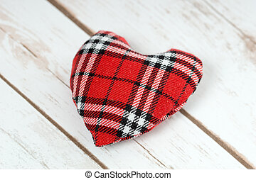 Love - checkered heart on a wooden board