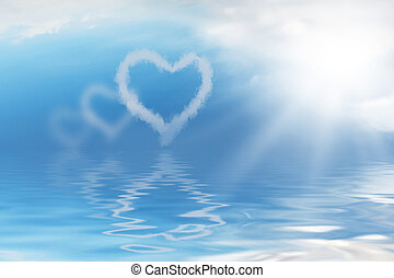 Background with hearts from clouds on blue sky, reflected in peaceful water