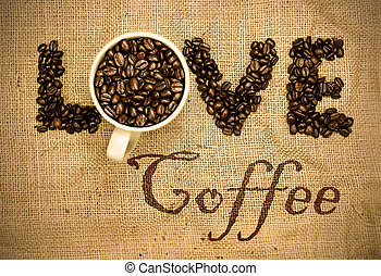 love coffee, coffee beans and mug used to spell love on ...