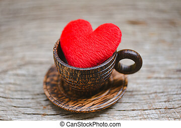 Love coffee concept - Heart in wooden coffee cup romantic love valentines day on wood background