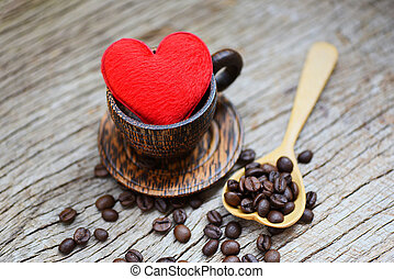 Love coffee concept - Heart in wooden coffee cup with coffee beans romantic love valentines day on wood background