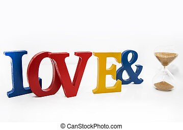 Love colored wooden letters on white background.