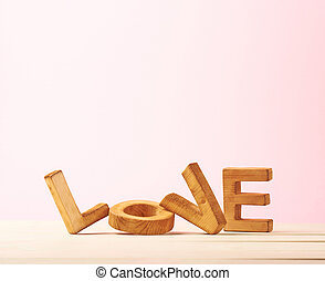 Love composition of wooden letters
