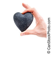 Love concept - female hand holding heart