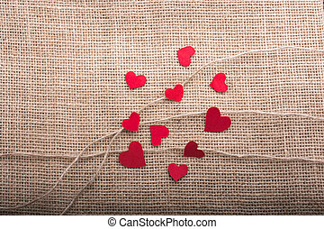 Love concept with heart shaped icons on threads