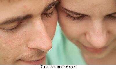 Love couple cheek to cheek. Close-up. Gentle movement