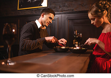 Love couple eating in restaurant, romantic date
