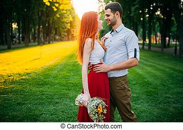 Love couple hugs on sunset, romantic meeting