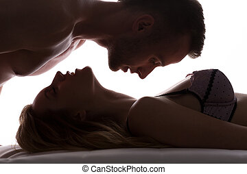 Love couple in bed - Sexy love couple in bed having foreplay