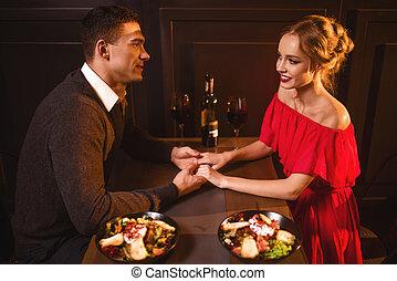 Love couple in restaurant, romantic evening