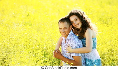 Love couple in the meadow. Look at