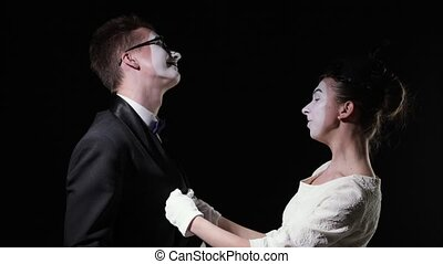 love couple mimes. girl mime and man mime hugging - love...