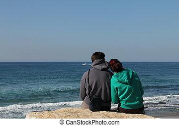 Love couple near the winter sea