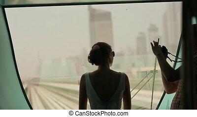 Love couple ride on a train Dubai Metro and photographed