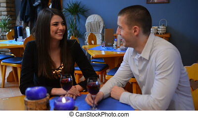 love couple sitting at a table