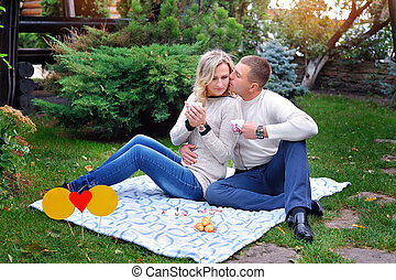 love couple sitting on a bed