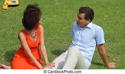love couple sitting on the grass