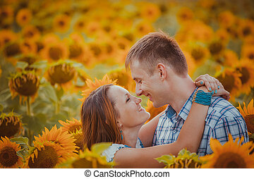 love couple standing outdoors in sunflower field