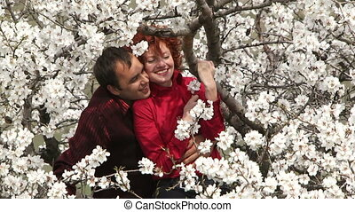 Love couple sitting in a tree.