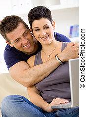 Love couple using laptop computer
