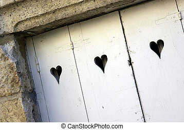 Love door - Image of an ancient door with hearts carved in ...