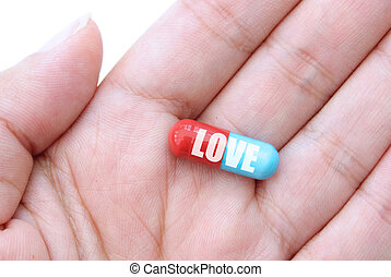 Love dose - Hand holding a capsule labeled love