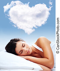 Love dreams - Portrait of a young girl sleeping on a pillow ...