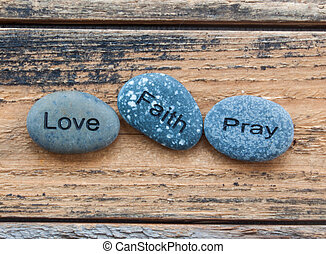 Love, Faith, Pray rocks.
