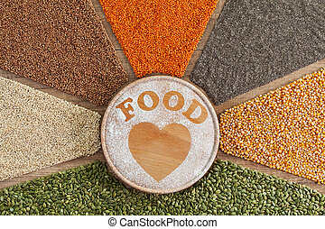 Love food concept - plant based food with diverse grains and seeds