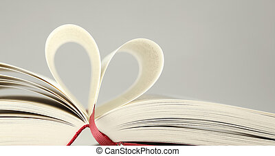 love for books - open book with pages forming the shape of a...