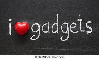I Love gadgets phrase handwritten on blackboard