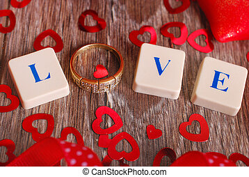 love game - love word made of scrabble letters and golden...