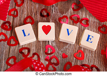 love game - love word made of scrabble letters and heart...