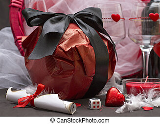 Love game with game dice, glasses, chocolate, wine bottle and candle for a special party for two, Valentine's day