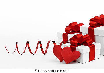 Love gifts - Gifts boxes with red ribbons and textile...