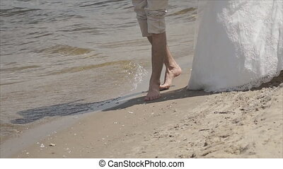 love going barefoot in the wet sand along the river