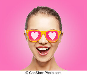 amazed teen girl in sunglasses - love, happiness and...