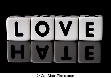 Love Hate Concept - Love spelled in dice with the word hate...