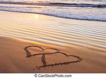Love, heart on sea beach