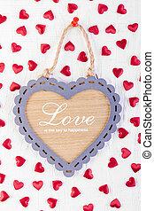 Love heart on wooden texture