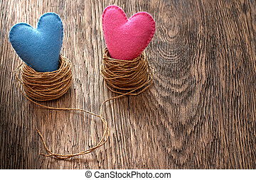 Love hearts handmade on wood. Valentines Day. Couple in nests