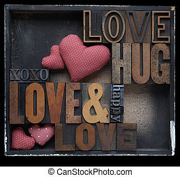 love hug happy - love and related words in wood and metal...