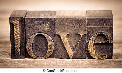 Love in printing blocks - The word LOVE wriiten with vintage...