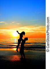 Loving Couple in Front of Sunset