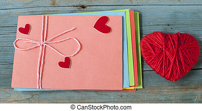 love letter envelope with red heart on wooden background