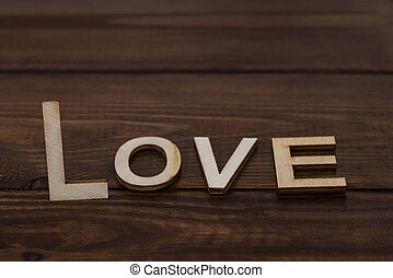 love lettering wooden letters on wood background with copy space